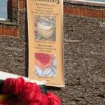 large Awakening Exhibition banner @ Village Market
